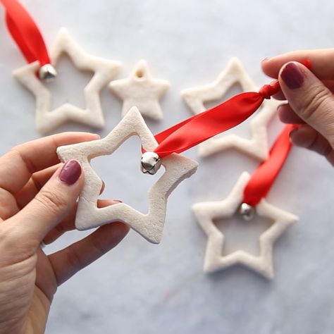 These salt dough ornaments are so easy and fun to make! They make such a festive ornament to hang on your Christmas tree. Kids will love helping to make these too! Perfect for a DIY Christmas ornament gift.   #bestideasforkids #kidscraft #kidsactivities #christmas #christmascrafts #diy #christmasdiy #christmasornament #ornamaments #handmade #crafts #easycrafts