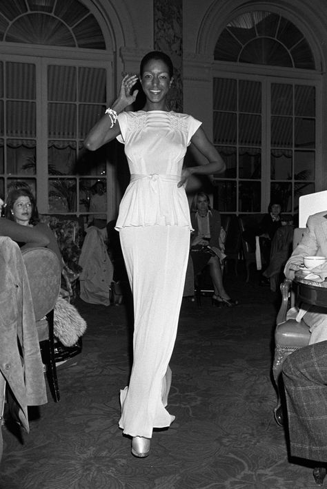 Billie Blair: A top model in the Seventies and Eighties, Blair's air of poise made her a go-to eveningwear model. Here, Bruce Oldfield spring 1974.  Photo by Pierre Schermann