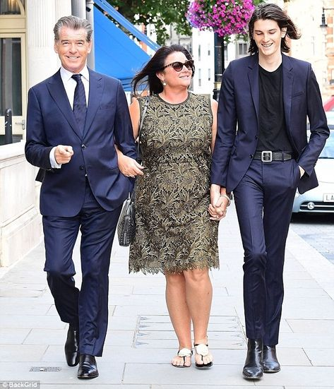 Photo of Pierce Brosnan with his wife and tall son - Just a lovely! They look like they are bonding, James Bonding.