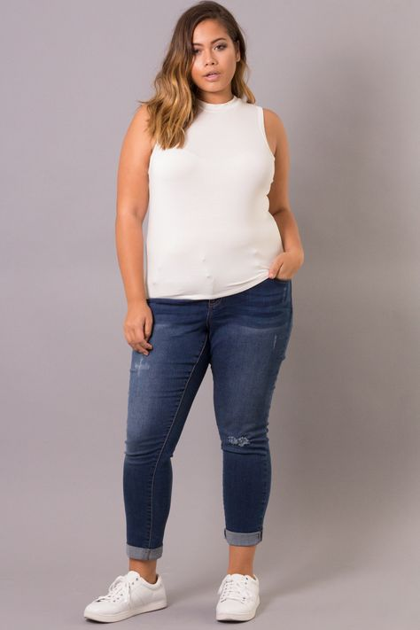Curvy Sense plus size crop top features a mock neck and sleeveless body. Made in… Curvy Sense plus size crop top features a mock neck and sleeveless body. Made in USA Content + Care Rayon Spandex Machine wash cold Size + Fit Model: wearing
