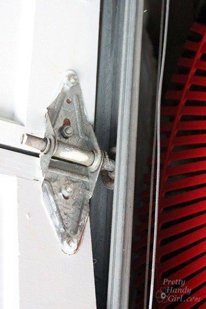 How To Replace Garage Door Rollers Garage Door Rollers Garage Doors Garage Door Installation