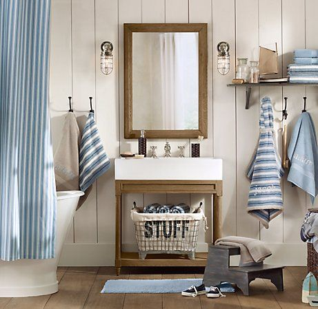 I love the idea of a nautical bathroom. The theme would need to be subtle since the rest of the house looks aesthetically different.