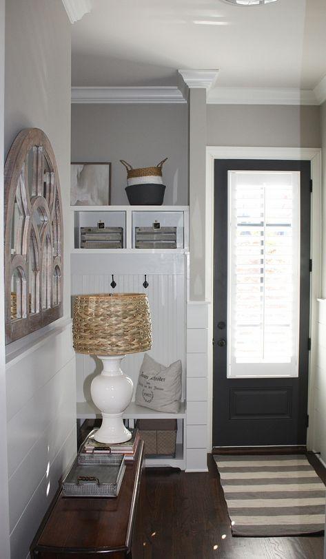 Small Mudroom With Grey Interior Door Painted In Benjamin Moore