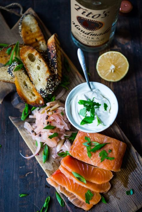 Have you ever made lox at home? It's so easy! This simple recipe for Salt Cured Salmon with rosemary, juniper berries (optional) vodka and lemon zest requires only a few minutes of prep, and then watch as nature takes its course. | www.feastingathome.com