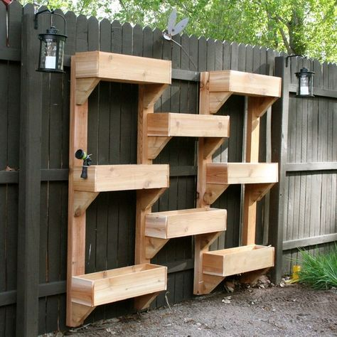 How cool is this? Home crafted vertical garden on a fence.#DIY #verticalgardens