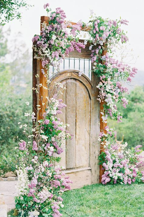 From the editorial A Breathtaking Garden Wedding Inspired by a Butterfly  Floral Monique Lhuillier Gown. Lilacs, Dogwood, Hellebores, Roses and Sweet Peas were used to create jaw-dropping floral arrangements by The Loved Co. Trust us, it's even more stunning than it sounds.  Photography: @lunademarephoto  #weddingceremony #weddingceremonyinspiration #weddingceremonyideas #gardenceremony