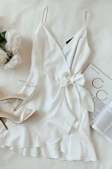 Lulus A white wrap dress outfit for every bridal event on the calendar. Make you… Lulus A white wrap dress outfit for every bridal event on the calendar. Make your special day complete with simple gold hoops and white ankle strap […] Wrap Dress Outfit, White Wrap Dress, Boho Dress, White Dress Outfit, White Ruffle Dress, Gold Outfit, Cute Dresses, Casual Dresses, Casual Outfits