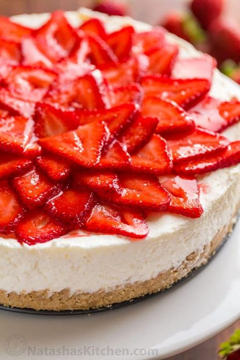 This No-Bake Cheesecake is an elegant, crowd pleasing summer dessert. From the crust to the velvety whipped cheesecake center, this is 100% a NO-BAKE dessert. Mascarpone cheese elevates the flavor and texture of this easy no bake cheesecake and the double strawberry topping is lip-smacking good! | natashaskitchen.com