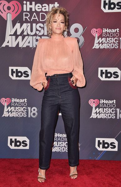 Rita Ora poses in the press room during the 2018 iHeartRadio Music Awards which broadcasted live on TBS, TNT, and truTV at The Forum.