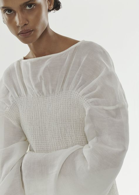 Summery blouse in a luxurious silk and linen blend. It has smocking details, a draping below the collar, extra long sleeves, and a loose fit. White Silk Blouse, Fashion Details, Fashion Design, Knitwear Fashion, Fabric Manipulation, White Shirts, Parisian Style, Fashion 2020, Fashion Fashion