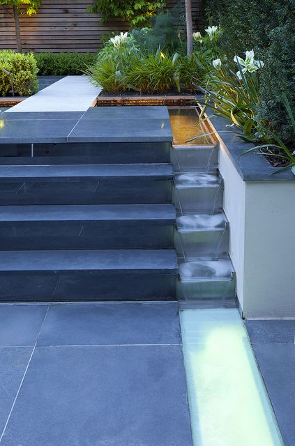 Party Garden in Chiswick | Water flows down flight of stairs to lit water rill in urban town garden | Charlotte Rowe Garden Design