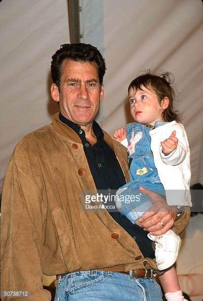 actor-paul-michael-glaser-holdinmg-his-daughter-at-pediatric-aids-picture-id50738712 412×612 pixels