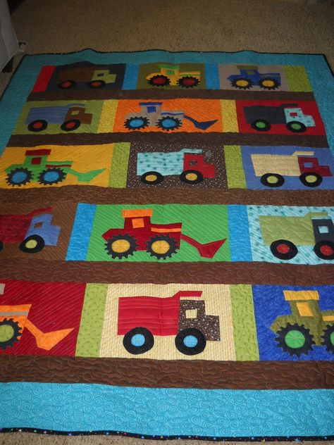 Where did you get the patterns for making the trucks, tractors and front loaders for this quilt. Description from sherimhoward.blogspot.com. I searched for this on bing.com/images