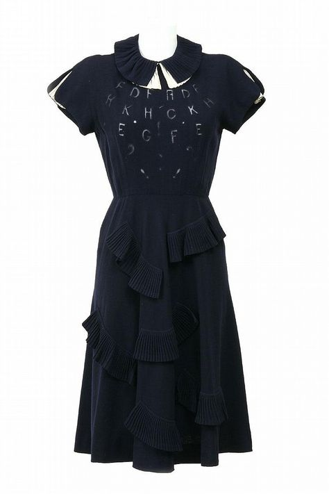 The Nina Ricci Dress Shop alphabet wool crepe pleated blue circa 1940