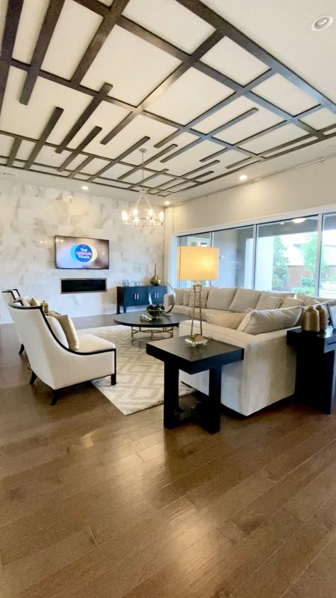 Beautiful modern ceiling molding design in this open concept living, dining room and kitchen.  Click to see more photos of model homes and get decorating ideas... THE DECORATING COACH  #livingroomideas