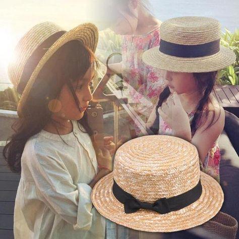 d7efc22a 2018 Cute Child Girls Boy Straw Bowknot Sun Hat Kids Large Brim Beach  Summer Boater Beach Ribbon Round Flat Top fedora hat 54CM