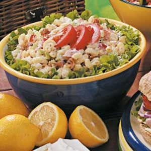 BLT Macaroni Salad ~ This pasta salad is like eating a BLT in a bowl. Chock-full of crispy crumbled bacon, chopped tomato, celery and green onion, the sensational salad is draped in a tangy mayonnaise and vinegar dressing. It's a real crowd-pleaser!