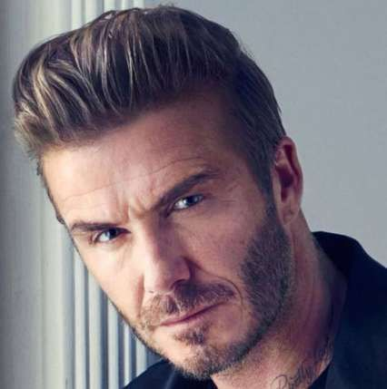 Medium Pompadour Haircut With Trimmed Sides Mens Hairstyles Pompadour David Beckham Hairstyle Celebrity Hairstyles