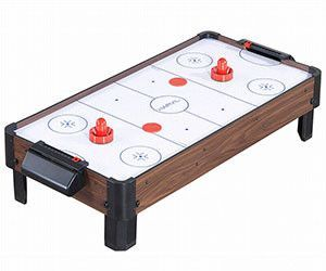 This Mini Air Hockey Table Has A Built In Fan To Give It That Authentic Air Hockey Feel Measuring Roughly 4 In 2020 Air Hockey Table Air Hockey Traditional Kids Toys