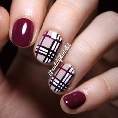 Beautiful plaid maroon nail art design. The combination of the white, black and maroon designs work well together as they are contrasting an make each color stand out.
