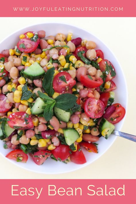 Easy bean salad is a simple and fulfilling salad that is based on pantry staples of a few cans of beans and corn. #simplerecipe #salad #beansalad
