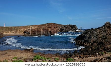 Most Typical Coastal Landscape Of The Southern Part Of Tenerife Island Showing A Very Arid Volcanic Terrain With Strong Frothy Waves And Crystal Clean Ocean And