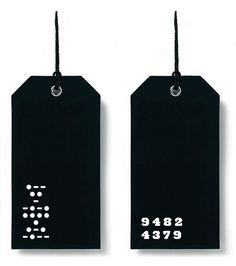 swing tags with laser cut detail one side... kraft paper