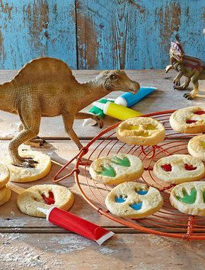 Get your roooaaarrrr on with these cute and creative dinosaur biscuits. Your little helpers will love stamping a dinosaur's foot in the dough and decorating the imprints with icing. Get your roooaaarrrr on with these cute and creative dinosaur biscuits Dinosaur Cookies, Dinosaur Cake, Dinosaur Birthday Party, Dinosaur Food, Elmo Party, Mickey Party, Dino Cake, Dinosaur Activities, Dinosaur Crafts