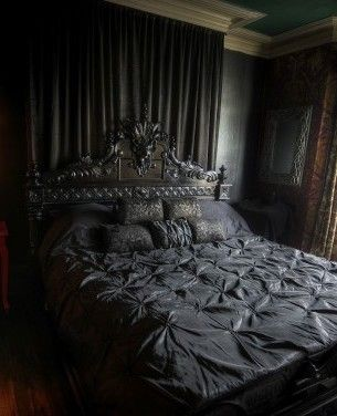 Black-metal-gothic-theme-for-a-large-black-bed-and-pillows-near-a-teak-wooden-table-for-teenage-boy-615x376