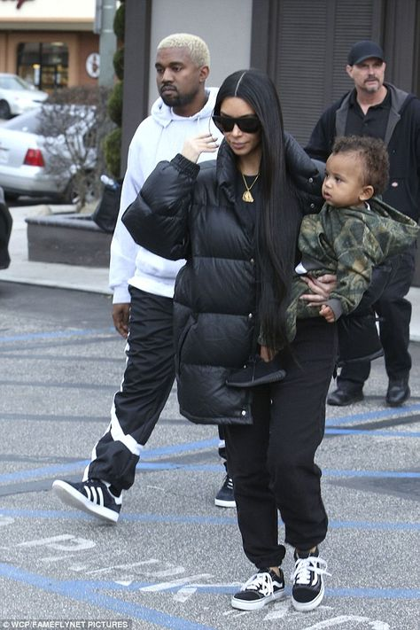 Adorable: Saint looked adorable in his camouflage hoodie with matching bottoms, adding Yeezys - from Kanye's Adidas line