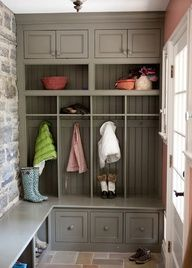 small mudroom. cubbies and wrap-around bench