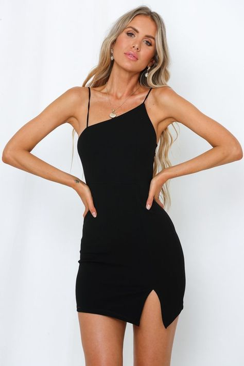 Beating Of Our Hearts Dress Black. Length from shoulder to hem of size S: 81cm. Black dress. Bust-lined. Model is a standard XS and is wearing XS. True to size. Mid-weight stretchy crepe.Invisible back zip. Polyester. Designed to showcase all your assets, our fitted Beating Of Our Hearts Dress features a contemporary asymmetrical neckline, elastic shoulder straps and an add an additional split vent to the thigh #hellomolly     Sour... #Beating #black #Dress #fashion dress classy #hearts
