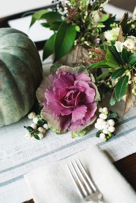 Cabbage mixed in with autumn plants as table setting.