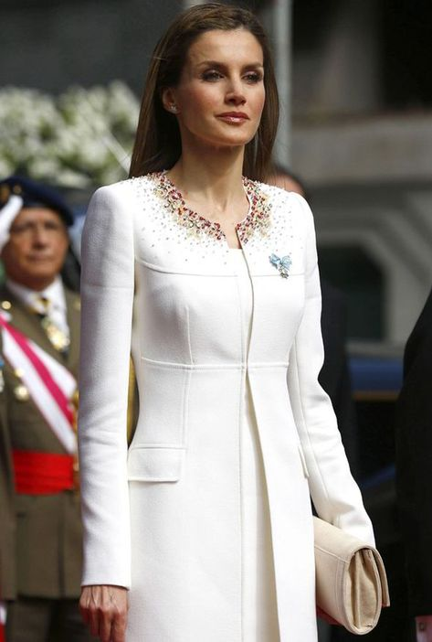 Queen Letizia is present as her husband receives his title as the new King of Spain and Letizia is his Queen. According to Spain's S Moda Fashion Magazine, everything Letizia is pictured as wearing sells out within hours!