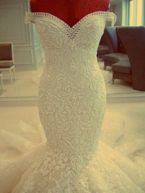 Stunning beaded wedding dress (don't like the top lace hanging over though)