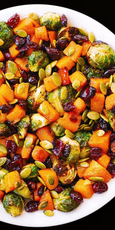 Roasted Butternut Squash with Brussels sprouts, Cranberries, Pecans Roasted Butternut Squa. Thanksgiving Sides, Thanksgiving Recipes, Vegetarian Recipes For Thanksgiving, Christmas Dinner Sides, Vegan Thanksgiving Dinner, Healthy Christmas Recipes, Christmas Side Dishes, Thanksgiving Stuffing, Holiday Recipes