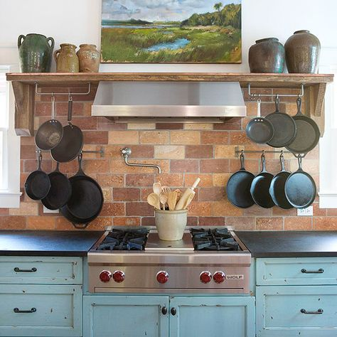 Like the brick look, but would want simulated brick for easy cleaning--pot hangers near the stove might work well; nice way to display art in kitchen w/hood in btween so as to protect art from steam & splashes
