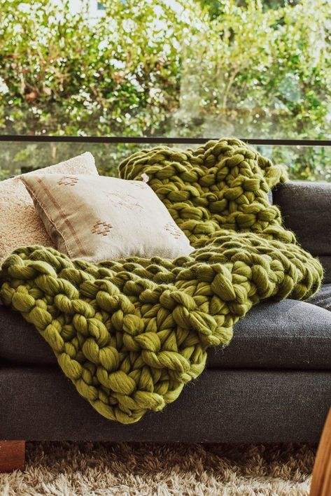Cozy up with this super chunky knit blanket made with 100% Merino wool.
