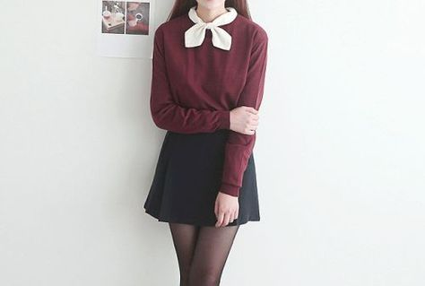 Cute fall schoolgirl inspired look with the burgundy long sleeve, black a-line skirt, black tights, and a white neck scarf.