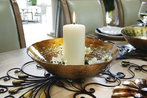 Use a metal wall hanging a as runner, add a pretty bowl, flower petals and candle...beautiful!