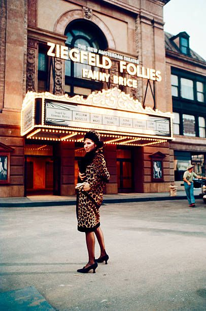 American actress and singer Barbra Streisand stands outside a theater...