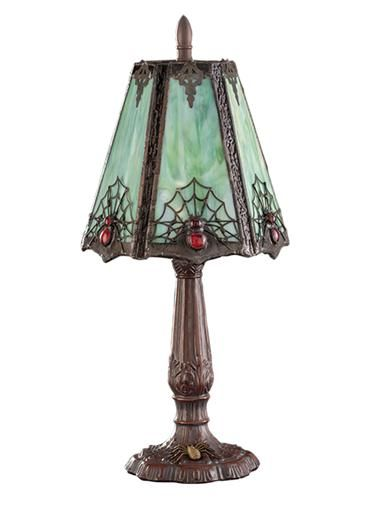 A gothic luminary glows in mottled hues of moss and burnt orange, revealing the silhouetted forms of web weavers and their handiwork. Exclusive Homes, Stained Glass Lamps, Tiffany Lamps, My New Room, Halloween Decorations, Halloween Candles, Halloween Pumpkins, Lamp Light, Interior And Exterior