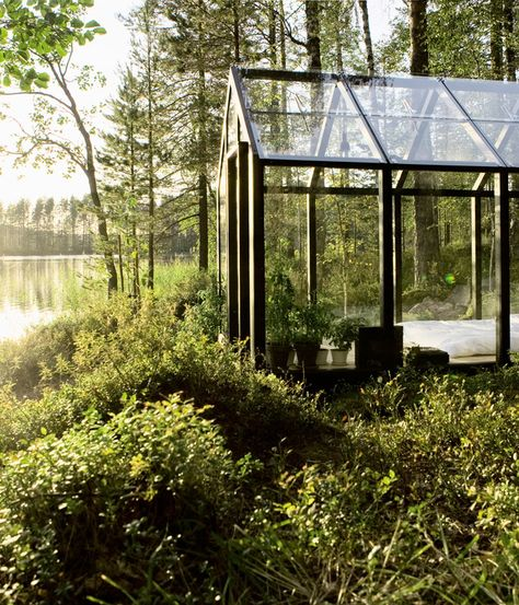 A bed of greens surround this grand prefab glass-walled shed-meets-sleeping-cabin on an island in Finland. Photo by: Arsi Ikäheimonen