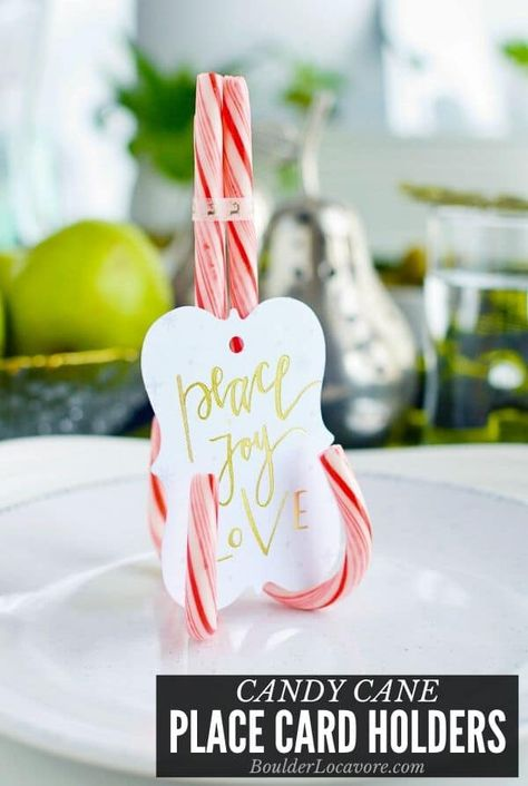 DIY Candy Cane Place Card Holders take 5 minutes to make and turn an ordinary table into a festive party! Add notes, name cards or photos. #DIY #craft #tabledecor #placecardholder #christmas