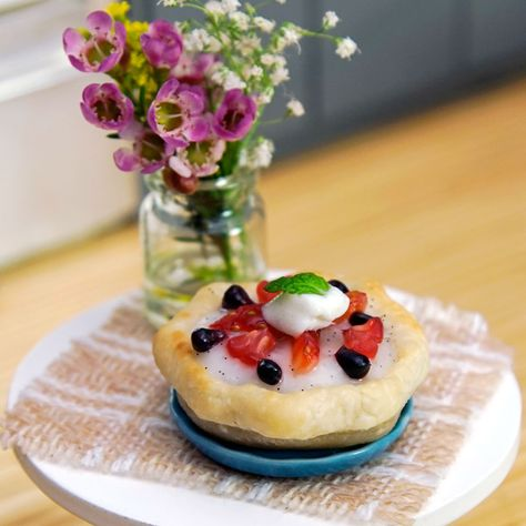 A tart that can sit on your finger tip is berry cute. Watch us bake this tiny dessert!