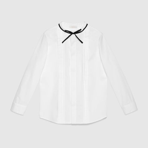48a174ac908 Gucci Children s white cotton poplin shirt with black ribbon detail at the  neck and a pleated front.