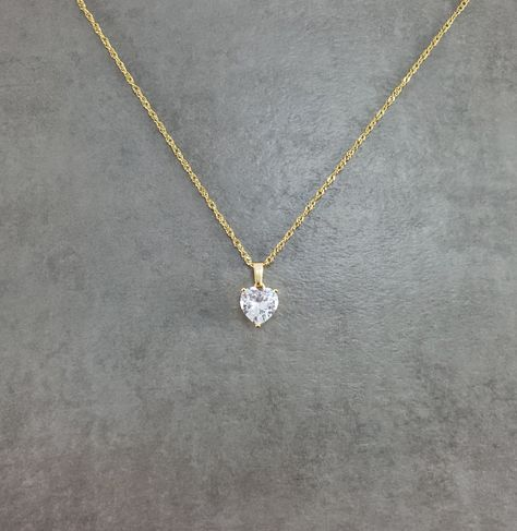 """""""A persons heart is the most important part about themselves. This dainty piece would be a great reminder of how big your heart is. The symbol of a heart stands for love, compassion, friendship, and family. Packaging: * Necklace will come in a small gift box. Pendant: *Gold plated *Cubic Zirconia *1/4 inch x 1/4 inch (6 mm x 6 mm) Chain: *Gold plated *1 mm in width *18\"""" in length"""""""