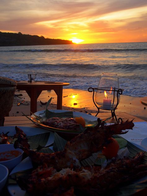 Jimbaran Bay, BALI.   Ocean side seafood dining during sunset.