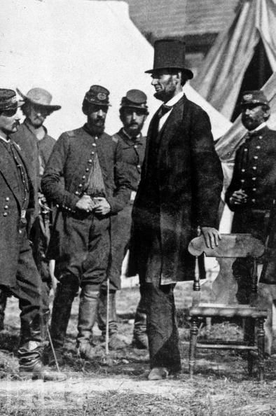 """President Abraham Lincoln meets with General George McClellan on the battlefield of Antietam in Maryland, 1862."""