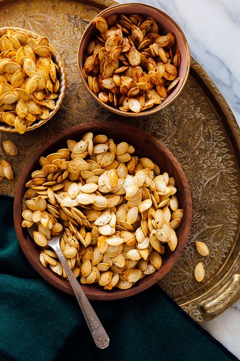 Learn how to roast pumpkin seeds at home! This fun and delicious recipe yields perfect pumpkin seeds every time. Plus, find tips and flavor variations! #pumpkin #pumpkinseeds #halloween #fallrecipe #cookieandkate
